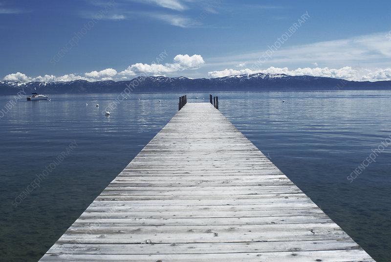 Wooden dock in still lake