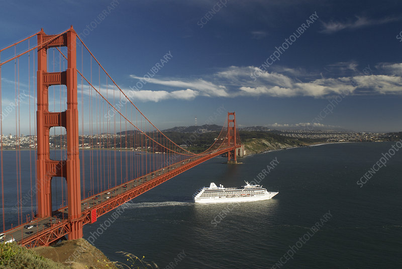 Ship sailing under Golden Gate Bridge