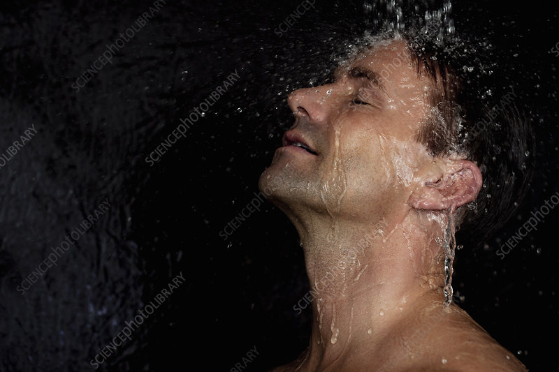 Man washing his hair in shower