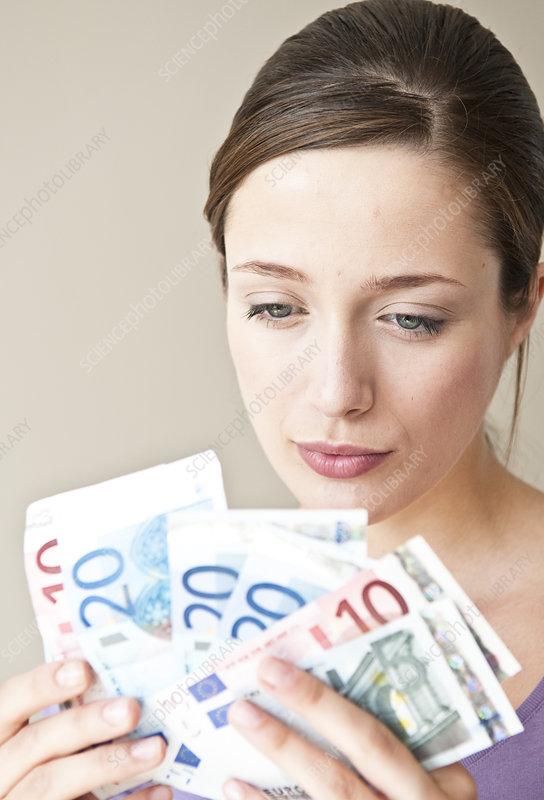 Woman counting Euro bills