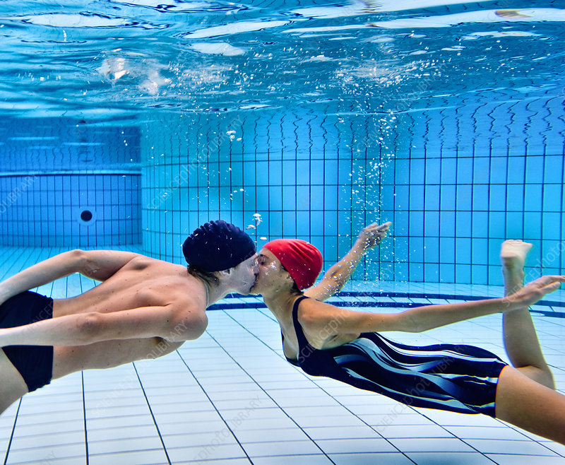 Couple kissing in swimming pool