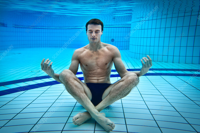 Man meditating in swimming pool