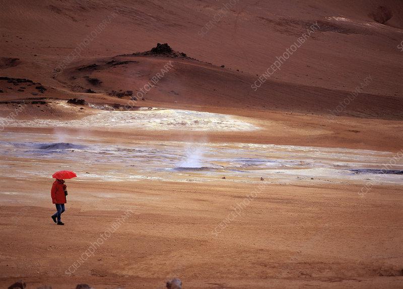 Woman walking in geothermal area
