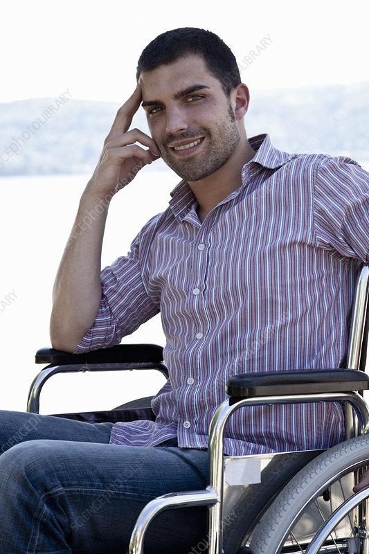 Smiling man sitting in wheelchair