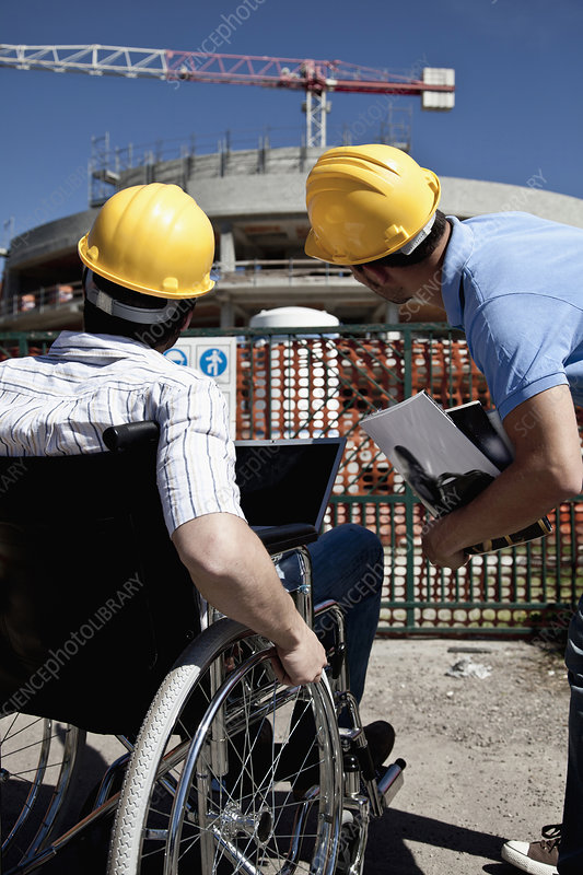 Man in wheelchair at construction site