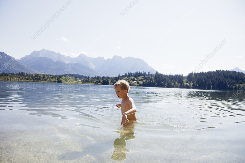 Boy swimming in lake