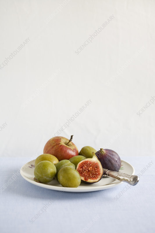 Plate of fruit on table