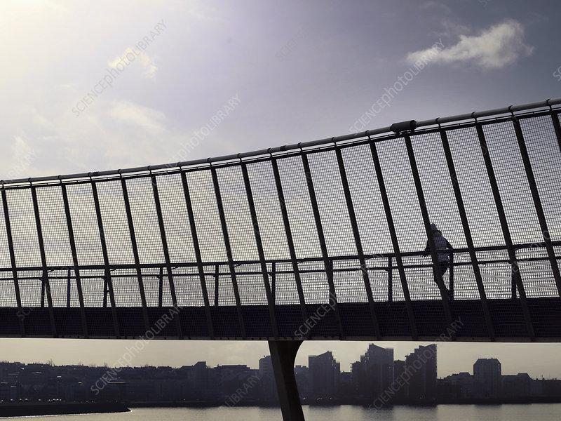 Man running on skybridge