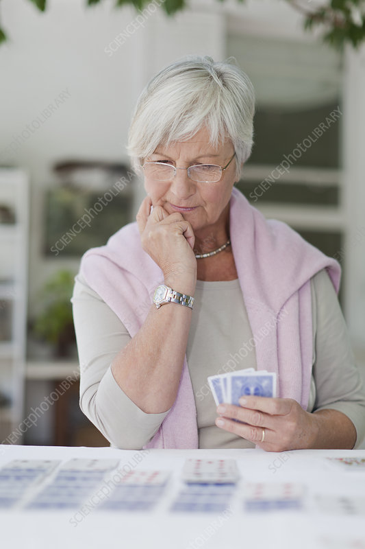 Older woman playing cards