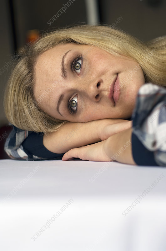 Woman resting on tabletop