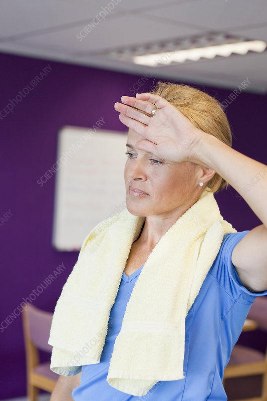 Woman toweling off in gym