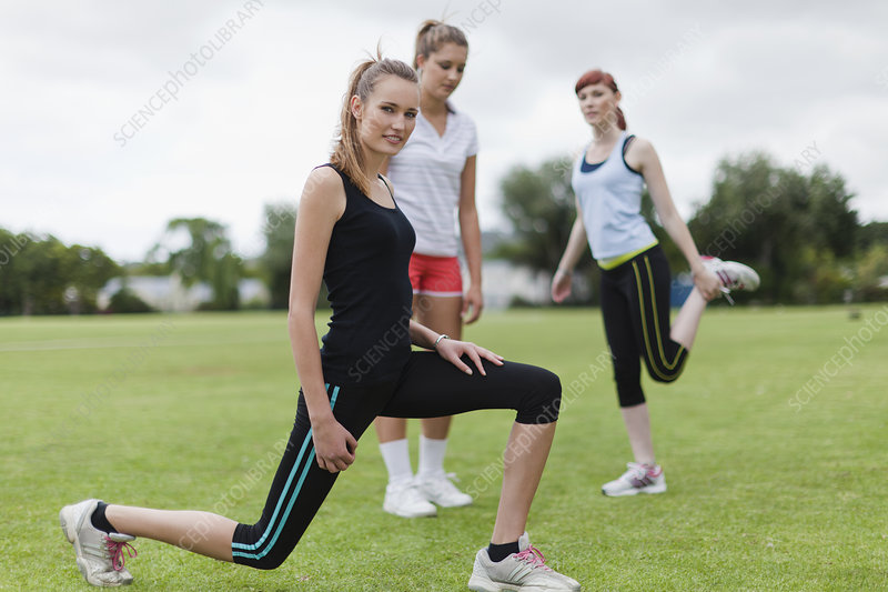 Runners stretching in park