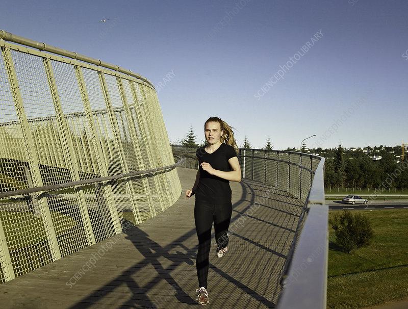 Woman running on skybridge