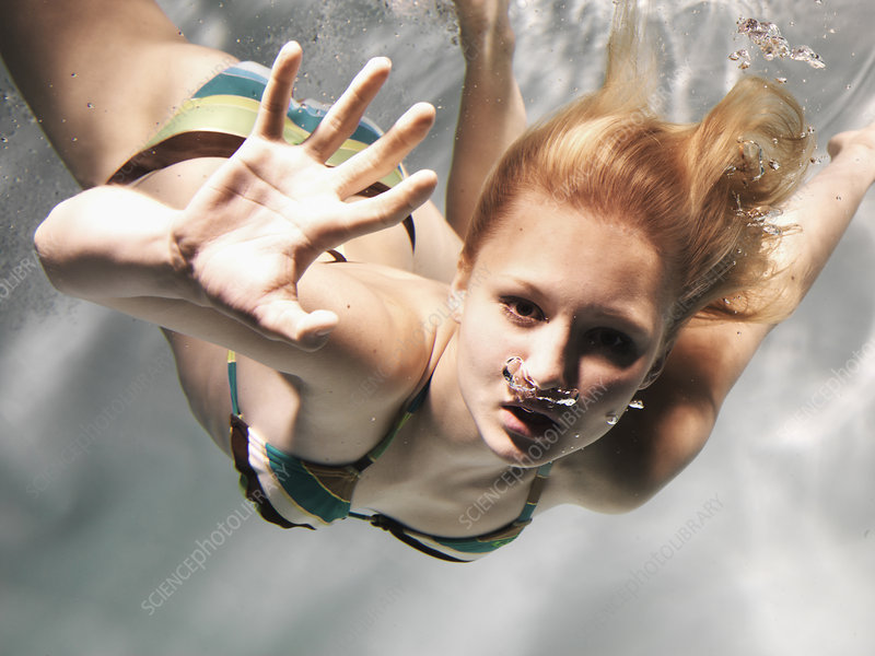 Swimming woman reaching out