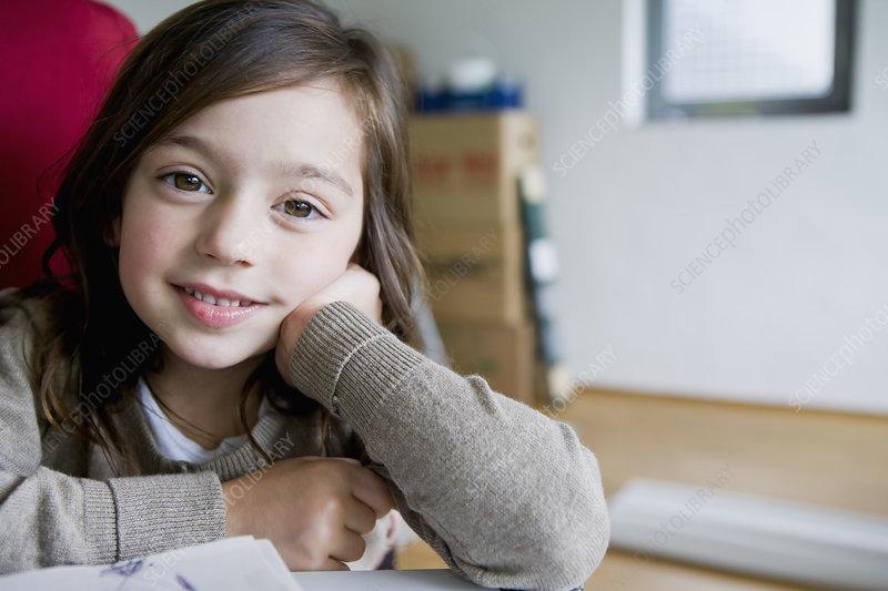 Smiling girl sitting at desk