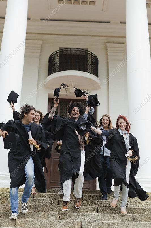 Graduates cheering on campus