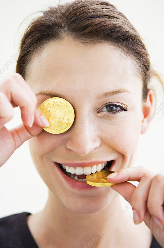 Woman playing with gold coins