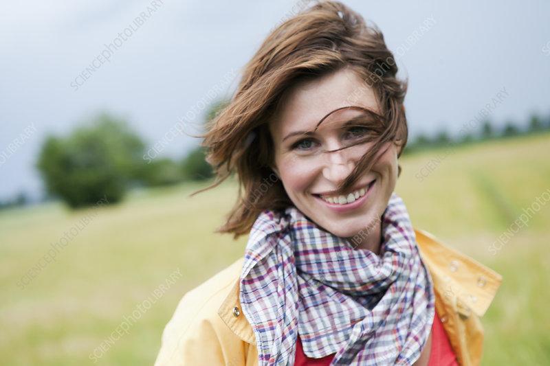 Smiling woman walking outdoors