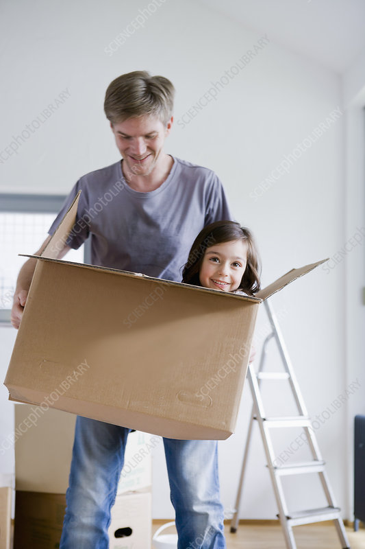 Father carrying daughter in box