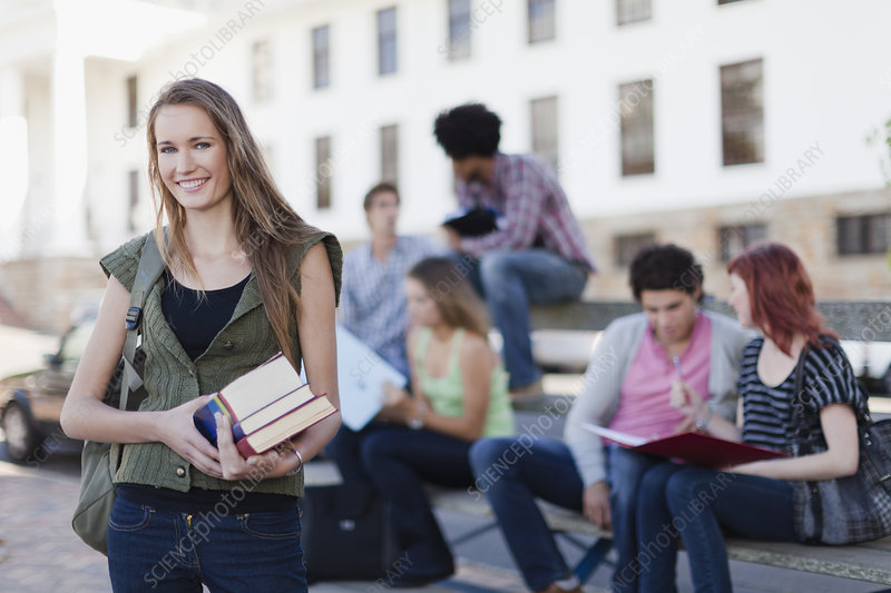 Student carrying books on campus