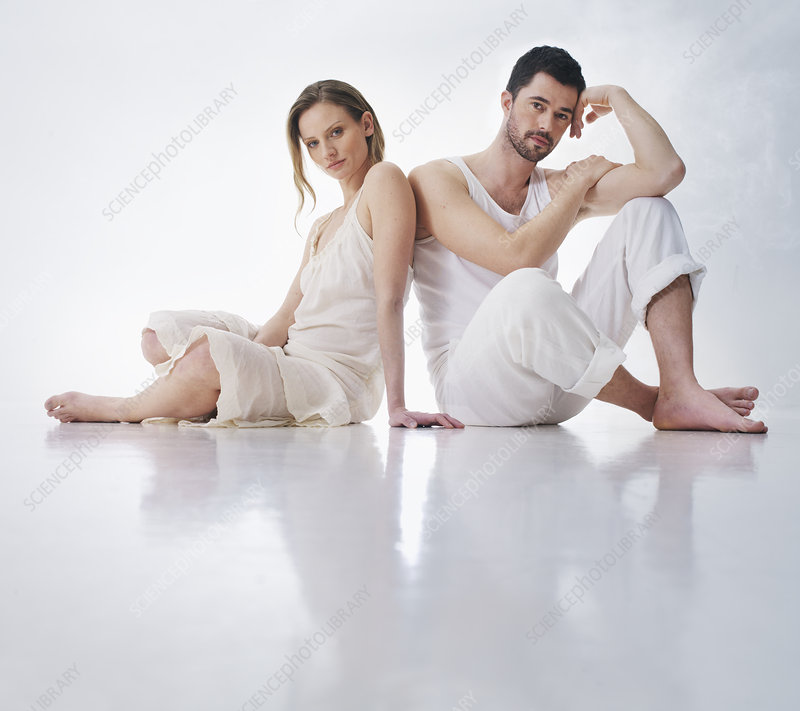 Couple sitting together on floor