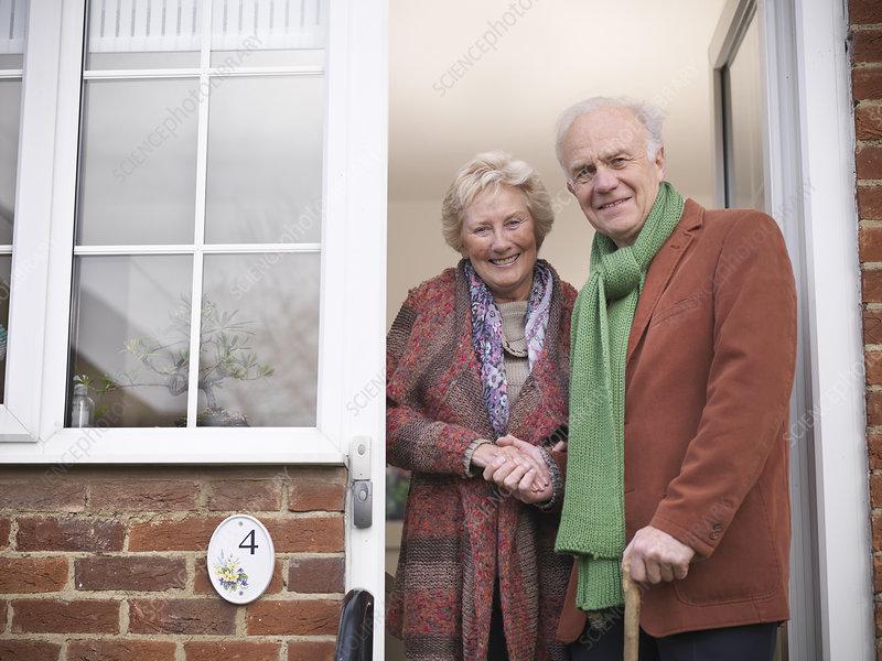Older couple standing in doorway