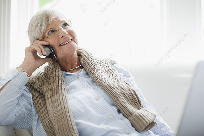 Older woman talking on cell phone
