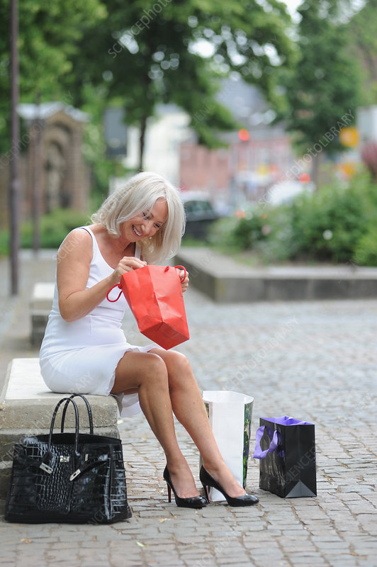 Woman examining shopping outdoors