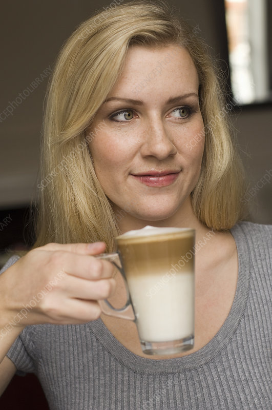Smiling woman having cup of coffee