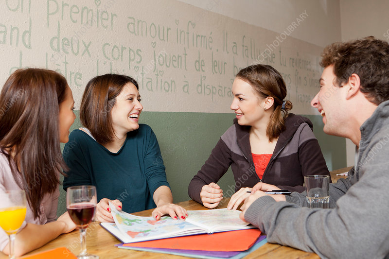 Students studying together in cafe