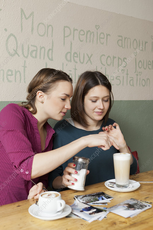 Women having cup of coffee in cafe