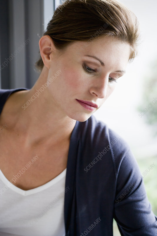 Close up of woman leaning on window