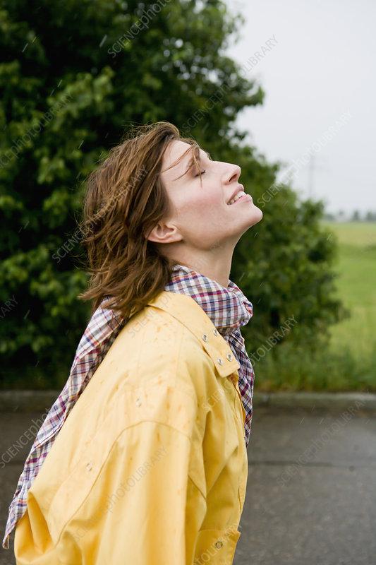 Smiling woman walking on rural road