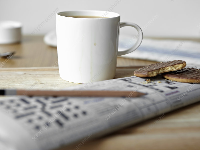 Tea, cookies and crossword on board