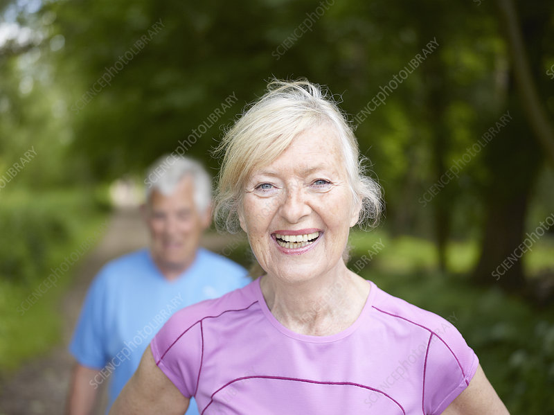 Smiling older woman standing outside