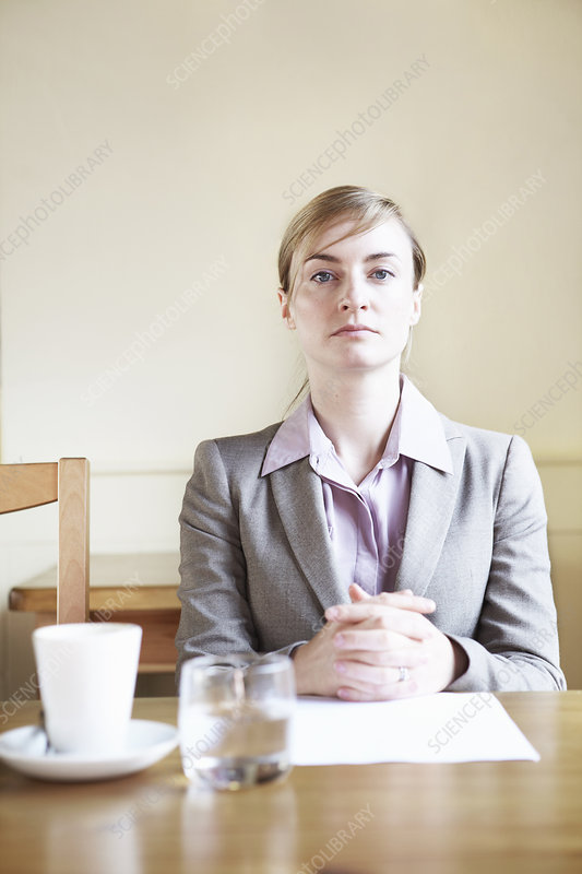 Serious businesswoman sitting in cafe
