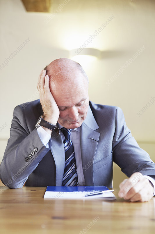 Frustrated businessman sitting in cafe