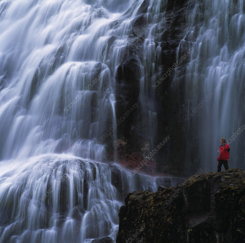Time lapse of hiker admiring waterfall