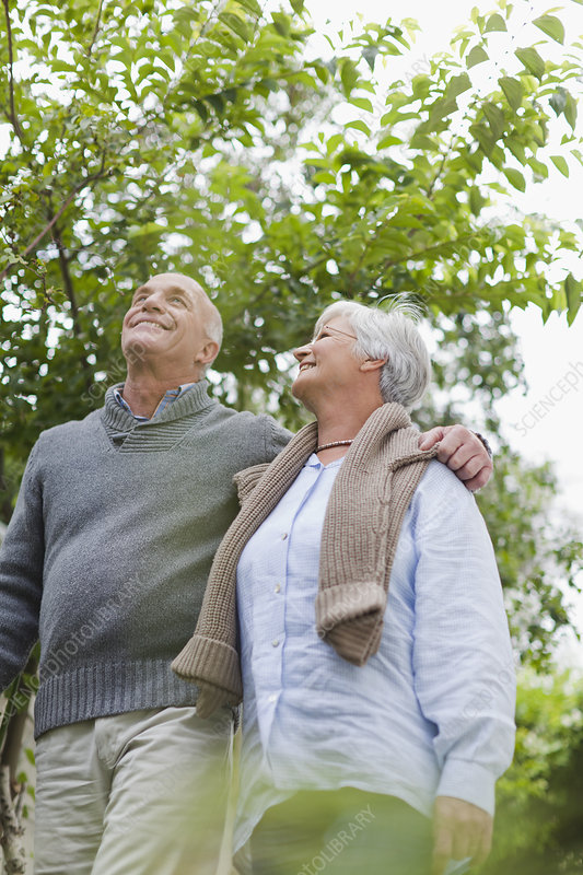 Older couple walking together outdoors
