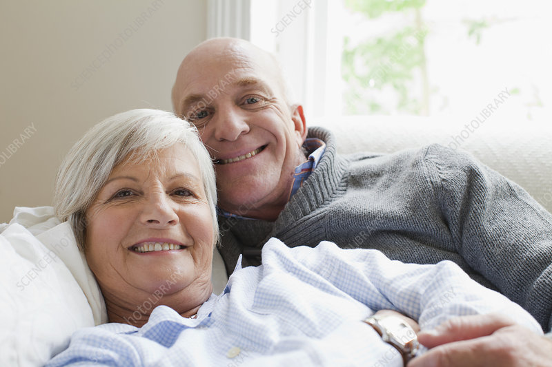 Smiling older couple relaxing together