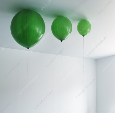 Different sizes of balloons on ceiling