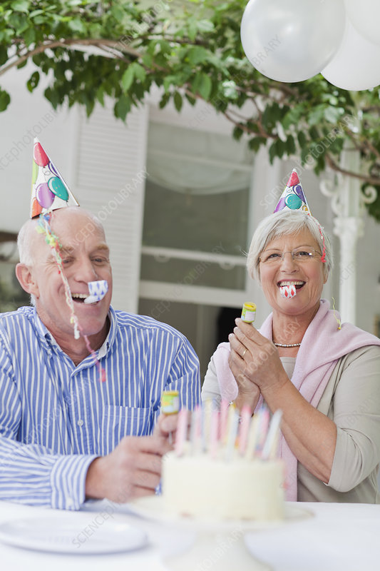 Older couple laughing at birthday party