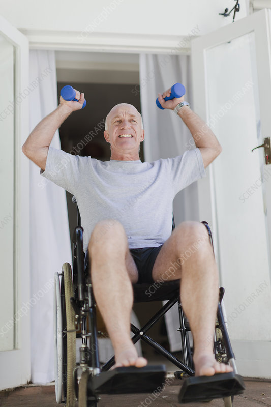 Older man in wheelchair lifting weights