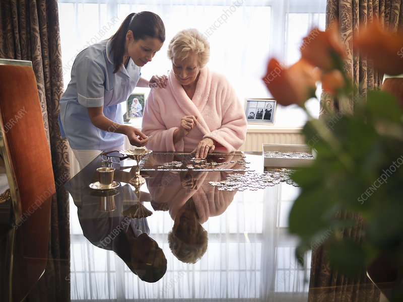 Nurse and older woman with jigsaw puzzle