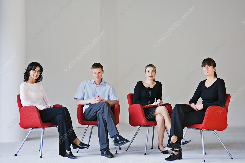 Business people sitting in office chairs
