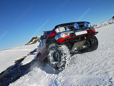 All-terrain vehicle driving in snow