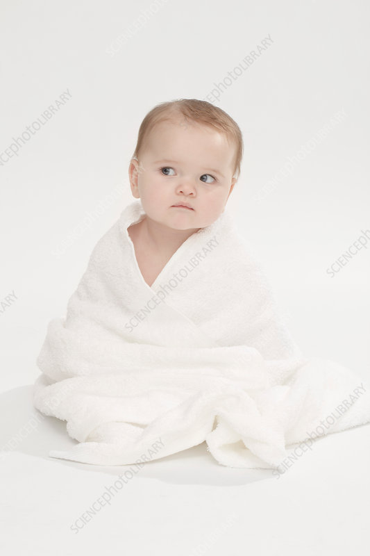 Close up of baby girl wearing bathrobe
