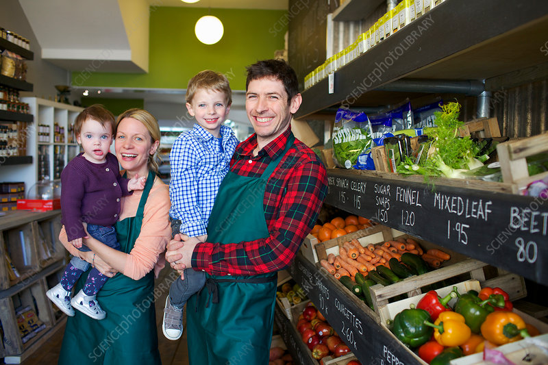 Grocers holding children in store