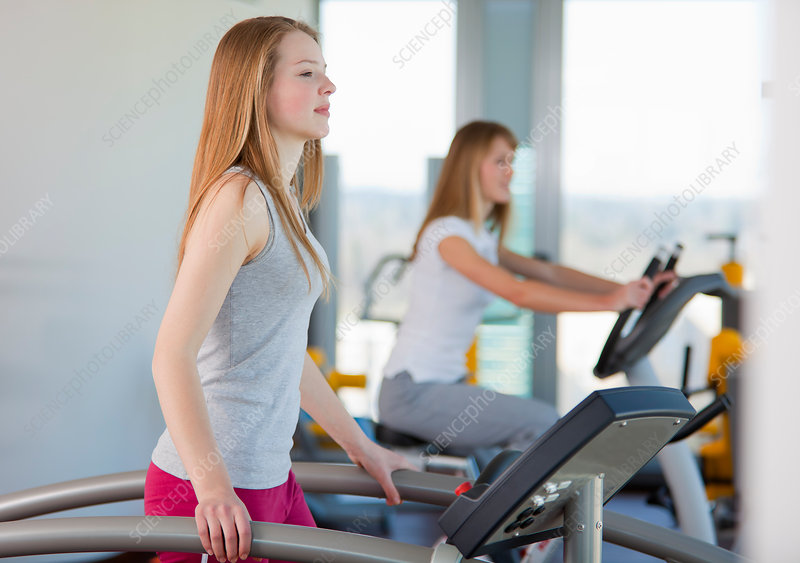 Girl using treadmill in gym