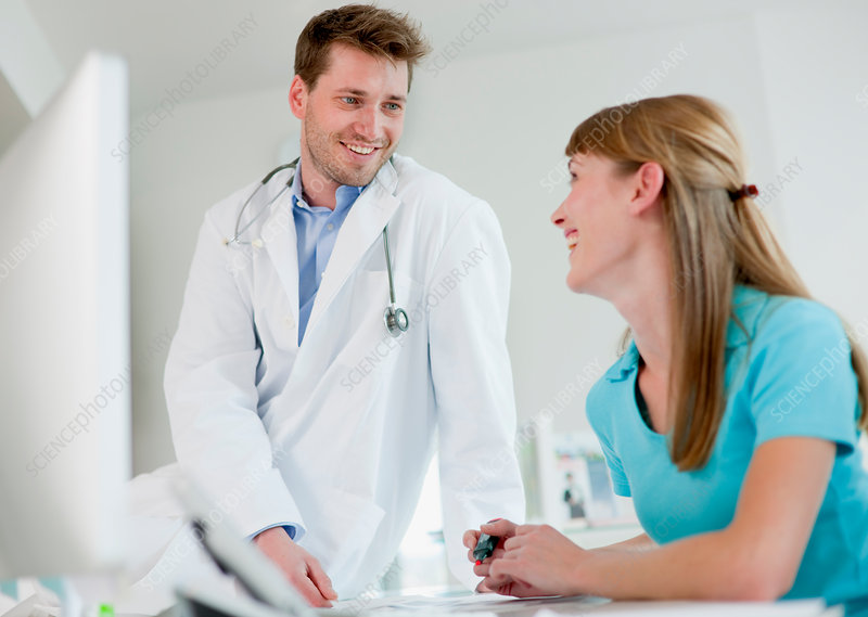 Doctor talking to receptionist in office